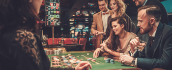 A group of friends gamble at a casino table